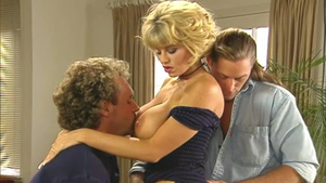 Blonde babe Joey Silvera escorted by large tits Julia Spain